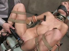 Calico gets her pussy fucked hard by that fucking machine, see how that dildo enters her vagina deep, fucking this horny slut until she screams with pleasure? The guy ties her pretty mouth and then another guy that is a repairman operates the machine, giv