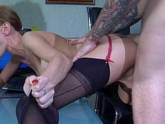 Nasty office hottie in seamed nylons sucks her sex-toy and gets nailed down