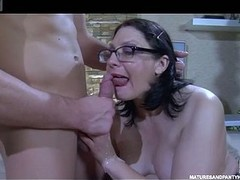 Darksome-haired mommy in glasses goes for oral 69 previous to hard pantyhose fucking