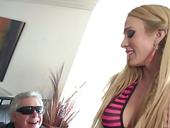 Tattooed blonde Sarah Jessie shows off her perfect large hooters and plays with her pierced clit. Busty woman in fishnets widens her legs and rubs dildo against her bald snatch
