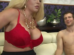 Good looking breasty blonde Allura Jenson in darksome nylons and red bra shows her assets to a slim guy and then plays with his meat pole. Allura Jenson acquires it started with a handjob