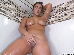 Gorgeous amateur is alone in the shower. While the hot water is running one of her hands is going over her nipples while the other is massaging her constricted pussy. Solo girl.