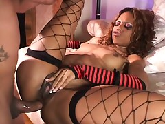 Lustful chocolate babe in fishnets feeds her hungry ass a lengthy stick