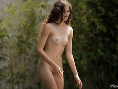 Vanessa with miniature tits and bald twat posing for you to enjoy in solo scene