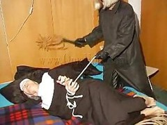 An old nun is about nearly experience something that she never though it`s possible. This golden-haired unties her hands and gives the old bitch some whipping. She then rolls her over whips her some nearly and begins nearly undress. This is a classic and